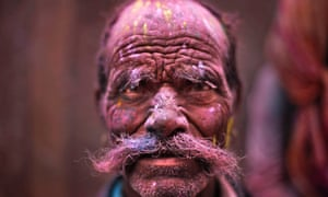 A Hindu devotee, face smeared with coloured powder, leaves the Banke Bihari temple during Holi celebrations in Vrindavan, India. Holi, the Hindu festival of colours and also marks the advent of spring.