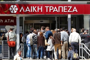 People wait to enter at a branch of Laiki Bank shortly after it opened in Nicosia March 28, 2013.