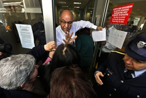 Cyprus banks: A Laiki Bank manager tries to calm depositors waiting for the opening