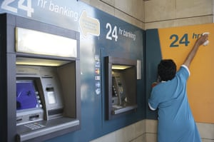 Cyprus banks: A woman cleans cash points