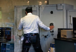 Cyprus banks: An employee opens a safe inside a Bank of Cyprus
