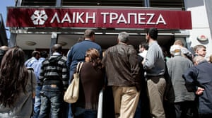 Cyprus banks: People gather in front of Laiki (Popula) Bank
