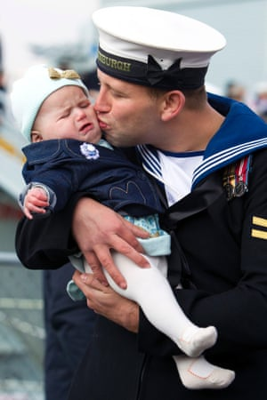 Did you miss me? Leading Seaman Kyle Broomhead from Barnsley doesn't quite get the reaction he'd hoped for as he kisses his daughter six month old Phoebe after returning from deployment aboard HMS Edinburgh, the Navy's last remaining Type 42 destroyer, at the Royal Navy Dockyard in Portsmouth.