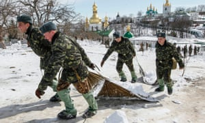 Snow patrol -  Ukrainian soldiers clear the grounds of the Pechersk Lavra, an Orthodox Christian monastery, in downtown Kiev, Ukraine. Over the last three days, 74 thousand tons of snow have been removed from the capital.