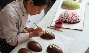 Perfect job for a chocoholic? Head chocolatier Chika Watanabe creates handmade Easter eggs in the Melt chocolate shop in Notting Hill, London.
