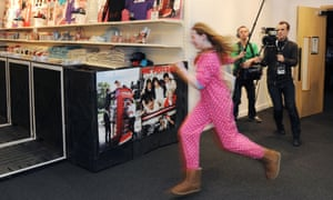 An excited fan hasn't even changed out of her pajamas in the rush to attend the opening of 1D World, a pop up merchandise store dedicated to the band One Direction at the 02 Arena.