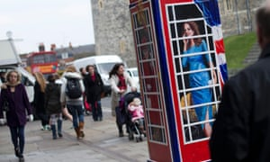 Surely Kate would never use a pay phone? A traditional British phone box that has been repainted by artist Timmy Mallet with members of the British Royal family on three of the sides, depicting Queen Elizabeth II, Prince Harry, and Kate Duchess of Cambridge, in Windsor, England. The phone box is part of a project BT Artbox.