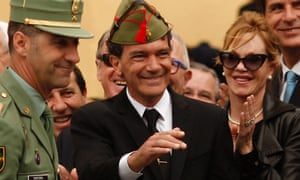 Legionnaire Banderas: Spanish actor Antonio Banderas waves to the crowd as his wife Melanie Griffith after he was appointed Spanish legionnaire of honor and given a chapiri (legionnaire hat) during a ceremony as part of the Mena brotherhood procession in Malaga, southern Spain.