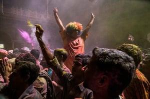 Holi festival: Hindu devotees at the Banke Bihari temple in Vrindavan, India