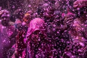 Holi festival: Hindu devotees play with colour at the Banke Bihari  in Vrindavan, India