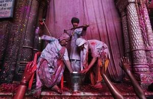 Holi festival: Hindu priests spray colored water on devotees inside Banke Bihari temple
