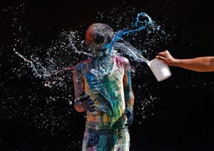 Holi festival: A boy smeared with colours reacts as water is poured on him in Chennai