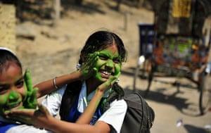 Holi festival: School girls play with coloured powder outside a school in Allahabad