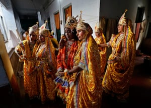 Holi festival: Indian widows dressed in costume wait to perform