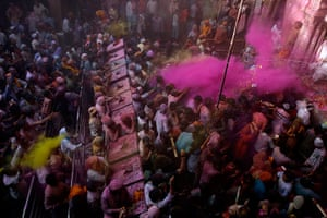 Holi festival: Hindu devotees throw coloured powder  at the Bankey Bihari temple