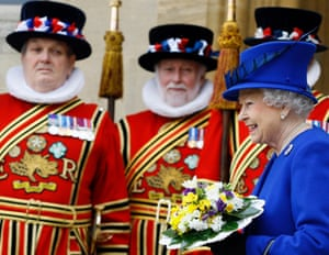 Queen Elizabeth smiles as she walks past Yeoman of the Guard, after attending the Maundy service, at Christ Church Cathedral in Oxford.