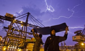 Lightening strike: Dock workers stage a sit-in as they go on strike over pay at the Kwai Chung Container in Hong Kong, China. The workers are demanding higher wages, claiming that they have not received a pay rise for 15 years.