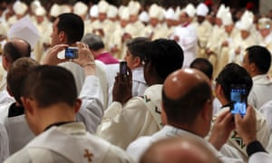 Priests show they can move with times as they take photographs with their smartphones as Pope Francis celebrates the Chrism Mass in St. Peter's Basilica at the Vatican. The Chrism Mass marks the start of the Easter celebrations.