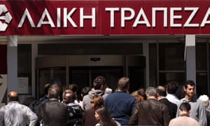 People queue outside a Laiki bank branch in Nicosia