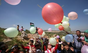 Palestinian children release balloons to mark Land Day in the village of Nazlet Zeid in the northern West Bank Jenin district, near the Jewish settlement of Shaked.