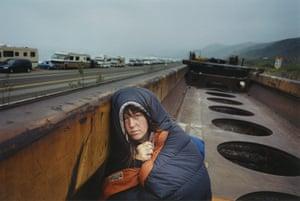 Train Riders: Girl in sleeping bag