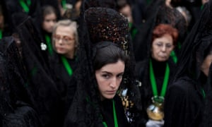 A penitent looks on outside the Cathedral during the Holy Week procession of the Cofradia de la Virgen de la Esperanza in Zamora, Spain. Easter week is traditionally celebrated with processions in most Spanish towns.