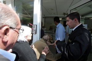 People enter a branch of Laiki Bank after the reopening of the bank in Nicosia, capital of Cyprus, on March 28, 2013.