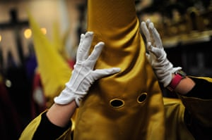24 hours in pictures: Pamplona, Spain: Penitent prepares himself before to take part on the proce