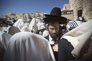24 hours in pictures: Jerusalem : Jewish men draped in prayer shawls perform the Cohanim prayer (