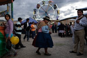 24 hours in pictures: Ayacucho, Peru: An indigenous woman walks at Canaan fair,