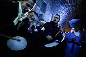 """24 hours in pictures: Cuenca, Spain: Penitents take part in the procession of the """"Road to Calvar"""