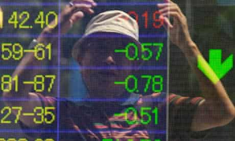 A man reacts to fall of Japanese stock market