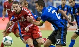 Montreal Impact's Davy Arnaud, right, takes on Toronto FC's Hogan Ephraim