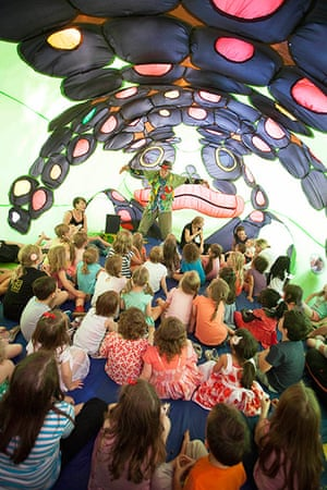Adelaide Festival Day 3: Children are told a story inside the inflatable frog