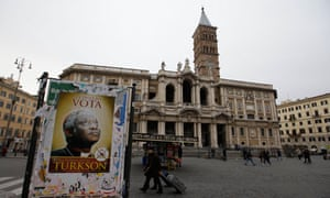 "A poster in Rome reading ""At the conclave vote for Peter Kodwo Appiah Turkson"""