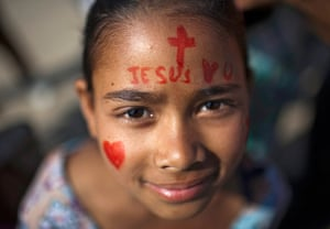 Easter Sunday: A Nepalese Christian girl with a painted face during a religious gathering