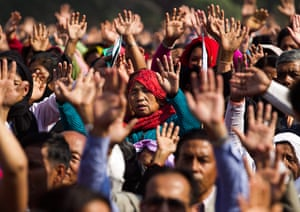 Easter Sunday: A group of Nepalese Christian pray at a religious gathering