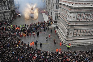 Easter Sunday: People watch the traditional Explosion of the Cart