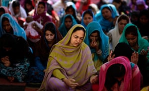 Easter Sunday: Christians pray at an Easter Mass in a Christian neighbourhood in Islamabad