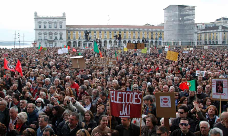 People gather to protest against government austerity policies at Lisbon's main square Praca do Comercio March 2, 2013.