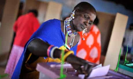 A Masaai woman casts her vote in a general election in Ilbissil, Kenya