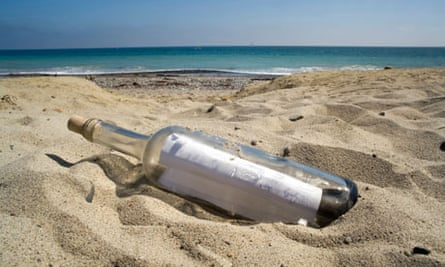 A bottle containing a message lies on a beach at sunset.. Image shot 2009. Exact date unknown.