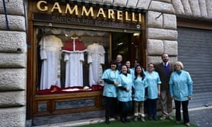 Staff outside Gammarelli tailors' shop where clothes of next pope are displayed