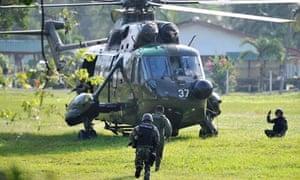 Malaysian commandos board a helicopter for the assault against Filipino gunmen in Borneo