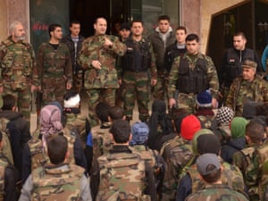 A Syrian Army officer briefs his men to prepare for an offensive in the northern city of Aleppo.