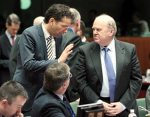 Dutch Finance Minister, eurogroup President Jeroen Dijsselbloem (L) chats with Irish Finance Minister Michael Noonan during the ecofin Finance Ministers meeting at the EU council headquaters in Brussels, Belgium, 05 March 2013.