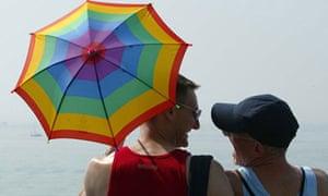 A gay couple soak up the sun