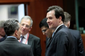 British chancellor of the exchequer, George Osborne (R) chats with Italian Finance minister Vitorrio Grilli (L).