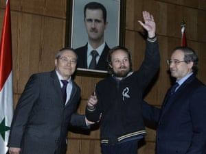Syrian deputy foreign minister Faisal Muqdad (left) is pictured with Billy Six, at a press conference in Damascus.