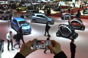 Geneva motor show: A person takes a picture of cars on Marc
